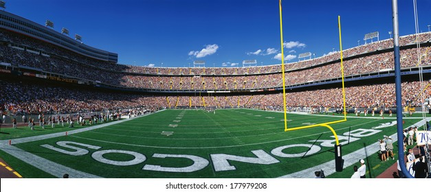 This is Mile High Stadium and the game is the Denver Broncos vs. the St. Louis Rams. It is a sold out NFL game that took place on 9/14/97.