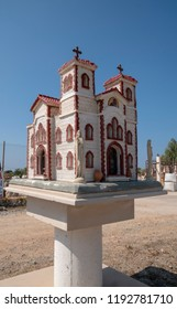 This miniature churches are old greek tradition. They are put on road sides for memory of victims of car crash. Also sometimes they are put for survivors of a car crash.