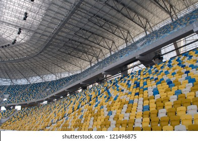 This is a modern stadium - Ukraine, Olimpiyskiy. Empty seats are colored with yellow and blue.