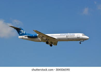 """This is the Montenegro Airlines Fokker 100 4O-AOM """"Dukley Gardens Resort"""" seen on the 2nd of August 2015 at the international airport of Zurich (ZRH), Switzerland."""