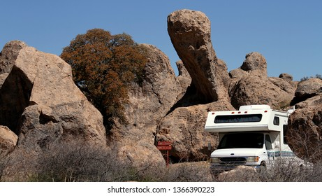 This motor home is parked at the City of Rocks State Park in New Mexico.  The park has large towering rocks that an RV or camper can park by and stay the night.  The park is located in the middle of t