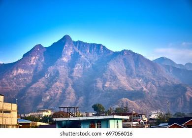 "This Mountain ist called ""Face of a sleeping Mayan"" and is between San Juan and Santa Clara at Lake Atitlan / Volcanic highlands of Atitlan in Guatemala / Rim of a giant volcanic crater"