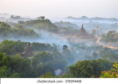 This is Mrauk-U pagoda , Myanmar from top view with the mist in the evening time