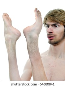 This mutated and mutilated human has his feet on his hands!
