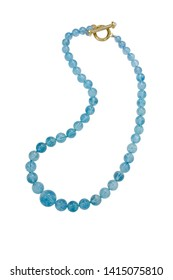 This necklace of progressive size round aquamarine beads are held together by a yellow gold T bar clasp. Shown on a white background.