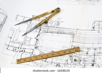 This is Old Drawing compass, ruler,  on engineering designs paper
