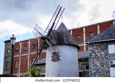 This old windmill stuck out at Port Louis harbor. This looked like nothing and nothing looked like it. I guess you don't need to complement something as beautiful as this, I complements it self.