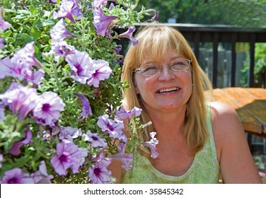 This older woman is happy while enjoying a carefree summer day at an outdoor cafe.