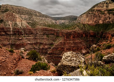 This is one of many beautiful  viewpoints along the Boucher Trail in the S Rim of Grand Canyon NP in Arizona. There is a steep drop off where I am standing, and a very high cliff across the abyss.