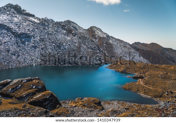 This is one the many lakes which resides in the Langtang region, Nepal. It goes by the name, Ganesh Kunda and is a popular trekking destination