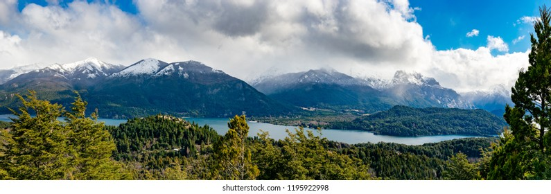 This is one of the most beatifull view in alture. Mountain Campanario, Bariloche Argentina. Trees, lake, mountains, clouds, this is beatifull view for you. Size:16600x5500