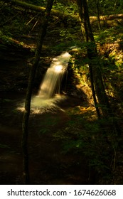This is one of the numerous waterfalls of World's End State Park in rural Pennsylvania. It was a partly sunny day with the sun peeking through the trees of the thick forest.