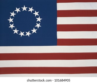 This is the original colonial flag with 13 stars representing the 13 original states at the time of the American Revolutionary War.