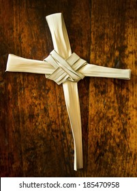 This Palm Branch was folded into a Cross shape and photographed on an antique wooden seat.  It represents the Easter Season including Palm Sunday and Good Friday. Palm Branch Cross is my creation.