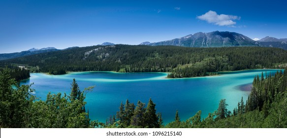 This Panorama of Emerald Lake, illustrates the clarity of the water.  It is located in the Yukon Territory of Canada.