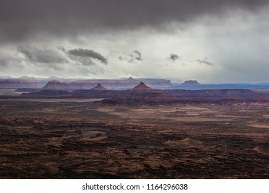 This panoramic view of the Needles Overlook in the Canyon Rims Recreational Area of Utah, is being engulfed in ominous storm clouds.