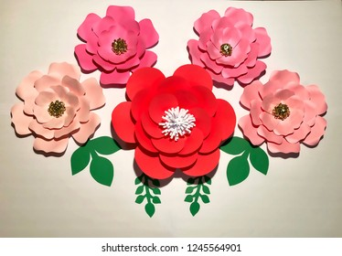 This is paper Flowers Backdrop.  The red flower is in middle of the four pink wild roses.  The pink wild roses has a gold stamen.
