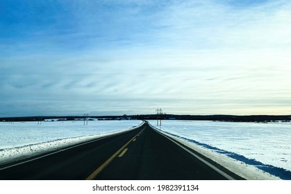 This path crosses the Quebec countryside. In winter sometimes the roads become passable. It is a country landscape. Quebec, Canada, January 24, 2021.