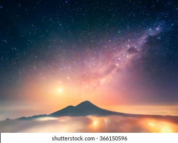 This photo was captured on Bali (Indonesia) just before the sunrise from the peak of Mt. Batur (1,717 m) with a view of Abang (2,151 m). To the left from it is a dazzling Venus.