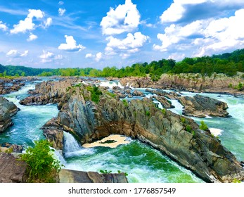 This photo captures the beautiful scenery of the Great Falls of Virginia, with it's beautiful blue sky and green horizon.