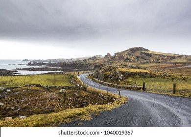 This is a photo of part of the Wild Atlantic Way in Donegal Ireland. It is a twisting winding coastal road that leads to Malin Head the northern most point of Ireland.