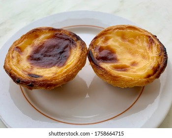 This is a photo of pasteis de nata, a Portuguese egg tart pastry.