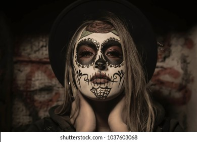 This photo represents the cultural roots of Mexican culture in the United States. This Mexican-American  combines the traditional  Mexican Day of the Death  with a more modern-American-Urban style.