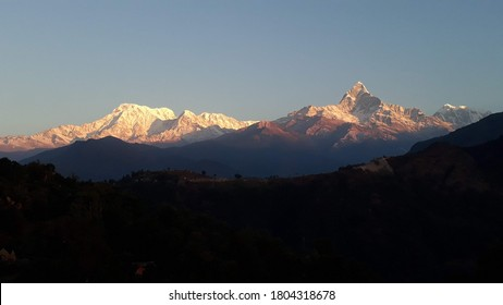 This photo shows the Annapurna mountain range and Mt. Macchapuchre (Fishtail mountain) reflecting morning sunrays.