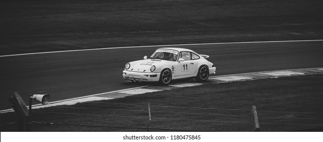 This photo was taken at the 'Classic Sports Car Club' in Donnington, Leicestershire / United Kingdom - September 15th, 2018: Retro Porsche 911 racing around Donnington Park race circuit