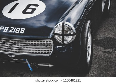 This photo was taken at the 'Classic Sports Car Club' in Donnington, Leicestershire / United Kingdom - September 15th, 2018: The front headlight of a vintage MG Midget racing car