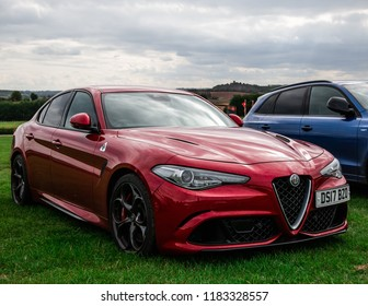 This photo was taken at the 'Classic Sports Car Club' in Donnington, Leicestershire / United Kingdom - September 15th, 2018: A modern, red Alfa Romeo Giulia Quadrifoglio