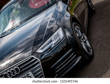 This photo was taken in Derby, Derbyshire / United Kingdom - May 27, 2018: A black Audi A4 saloon car.