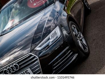 This photo was taken in Derby, Derbyshire / United Kingdom - May 27, 2018: A black Audi A4 saloon car.