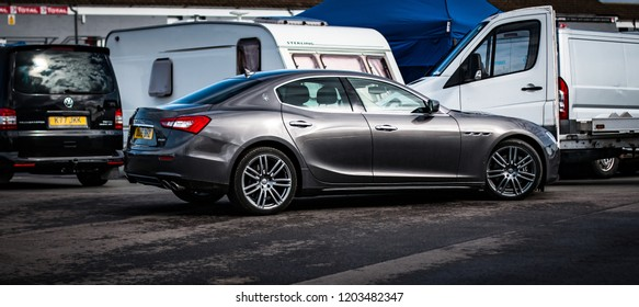This photo was taken in Donington, Leicestershire / United Kingdom - October, 13th 2018: Modern Maserati Ghibli saloon car