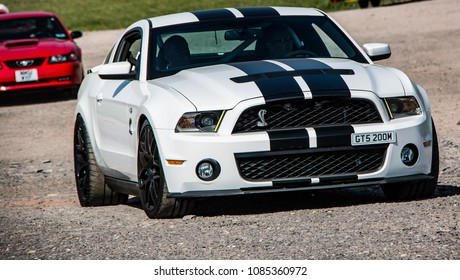 This photo was taken in Donnington, Leicestershire / United Kingdom - May 5, 2018: A white Ford Mustang GT500.
