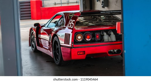 This photo was taken in Donnington, Leicestershire / United Kingdom - June 23, 2018: A red Ferrari F40 racing car.