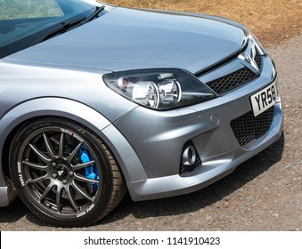 This photo was taken in Donnington, Leicestershire / United Kingdom - June 25, 2018: A silver sports car ( Vauxhall Astra VXR ).