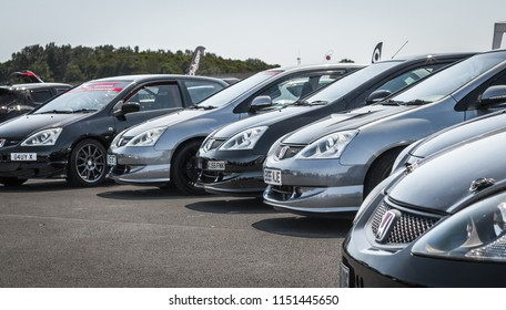 This photo was taken in Donnington, Leicestershire / United Kingdom - June 24, 2018: A line of modified Honda sports cars.