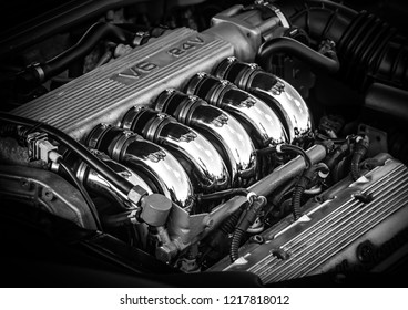 This photo was taken in Donnington, Leicestershire / United Kingdom - May 5, 2018: Shiny Alfa Romeo six cylinder engine