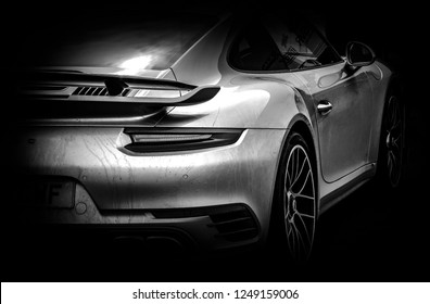 This photo was taken in Donnington, Leicestershire / United Kingdom - April 22, 2018: The back of a modern Porsche 911 Turbo sports car.