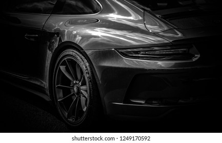 This photo was taken in Donnington, Leicestershire / United Kingdom - August 16, 2018: The rear light of modern Porsche 911 GT3 sports car.