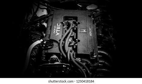 This photo was taken in Donnington, Leicestershire / United Kingdom - June 24, 2018: A black and white closeup of a Honda car engine.