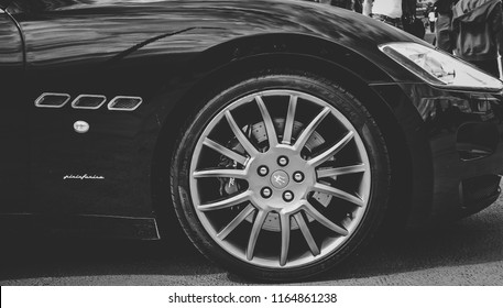 This photo was taken at the Etihad Football Stadium, Manchester / United Kingdom - June 8th, 2014: The front wheel of a Maserati Granturismo