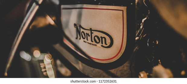 This photo was taken in Hockenheim museum / Germany - August, 15th 2014: A Norton sign on a vintage motorcycle