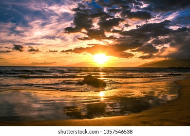 This photo was taken in Kamaole Beach in Kihei, Maui Hawaii. The Sunset on the Beach with Clouds and Sky and Reflection make it a Gorgeous Scenery.