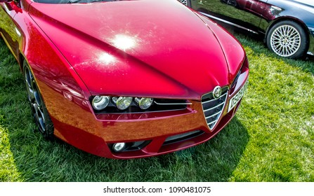 This photo was taken in Kettering, Northamptonshire / United Kingdom - May 6, 2018: A red Alfa Romeo Brera sports car.