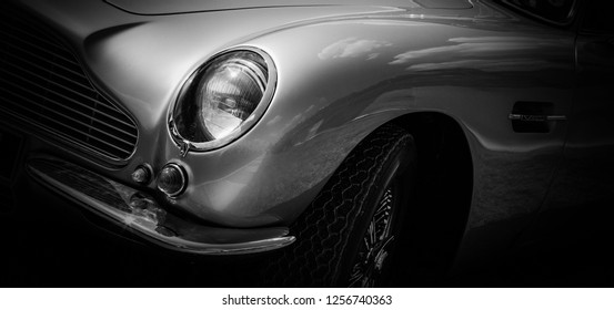 This photo was taken in Le Mans / France - July 7th, 2018 at Le Mans Classic: The headlight of a classic Aston Martin DB5.