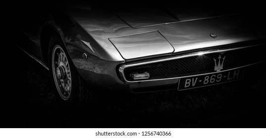 This photo was taken in Le Mans / France - July 7th, 2018 at Le Mans Classic: The front of a classic Italian Maserati Ghibli sports car.