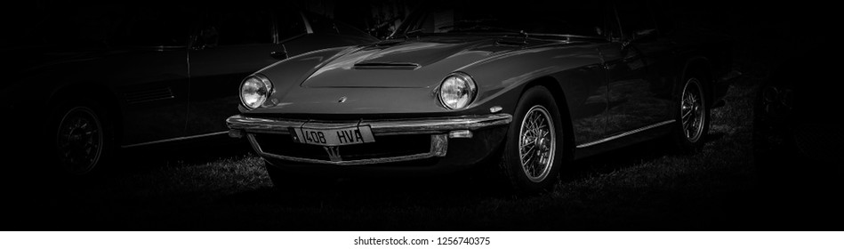 This photo was taken in Le Mans / France - July 7th, 2018 at Le Mans Classic: The front of a classic Maserati Mistral sports car.