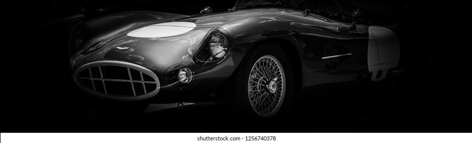 This photo was taken in Le Mans / France - July 7th, 2018 at Le Mans Classic: The headlight of a classic Aston Martin racing car.
